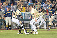 Vanderbilt Commodores pitcher Jake Eder (39) celebrates with his teammate Philip Clarke (5) after beating the Michigan Wolverines in Game 3 of the NCAA College World Series Finals on June 26, 2019 at TD Ameritrade Park in Omaha, Nebraska. Vanderbilt defeated Michigan 8-2 to win the National Championship. (Andrew Woolley/Four Seam Images)