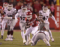 NWA Democrat-Gazette/BEN GOFF @NWABENGOFF<br /> Alex Collins, Arkansas running back, evades Mississippi State defenders in the first quarter on Saturday Nov. 21, 2015 during the game in Razorback Stadium in Fayetteville.