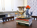 "Cookbooks and decorations atop the kitchen table. Photo taken on January 8, 2019 for ""At Home"" feature on Sandy Stolberg, who uses dollar store finds as part of the decorations in her Belleville, IL condo.<br /> Photo by Tim Vizer"