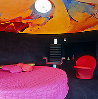 Each of the ten bedrooms is designed by a contemporary artist and features a large round bed