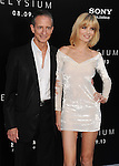 WESTWOOD, CA- AUGUST 07: Producer Bill Block and actress Eugenia Kuzmina arrive at the Los Angeles premiere of 'Elysium' at Regency Village Theatre on August 7, 2013 in Westwood, California.