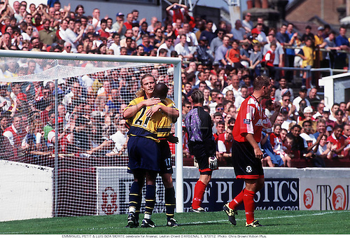 EMMANUEL PETIT & LUIS BOA MORTE celebrate for Arsenal, Leyton Orient 0 ARSENAL 1, 970712. Photo: Chris Brown/ Action Plus...1997.Soccer.celebration.celebrate.celebrating.celebrations.joy.celebrates.football.premiership premier league.club clubs