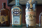 Artifacts in the whiskey musuem in Bardstown Kentucky include old bottles from J.W. Dant and crates from the Frankfort Distillery.