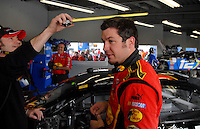 Feb 10, 2007; Daytona, FL, USA; Nascar Nextel Cup driver Martin Truex Jr (1) gets teased about the length of his hair by a crewmember during practice for the Daytona 500 at Daytona International Speedway. Mandatory Credit: Mark J. Rebilas