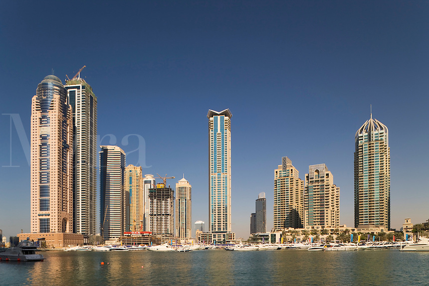 Dubai.  Apartment tower blocks and boats at Dubai Marina..