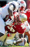TALLAHASSEE, FL 10/29/11-FSU-NCST102911 CH-Florida State's Jermaine Thomas leans forward for extra yardage as N.C. State's Terrell Manning drives him to the turf during second half action Saturday at Doak Campbell Stadium in Tallahassee. The Seminoles shut out the Wolfpack 34-0.COLIN HACKLEY PHOTO