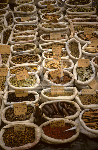 Rio de Janeiro, Brazil. Medicinal herbs, many from the Amazon, on sale in a street market; boldo, alecrim, bicuiba, gindiroba, cascara sagrada, urucum, carapia, jatoba, espinheira santa, jua, batata de purga, aroeira.
