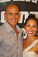 "Kelly Slater (USA) with girlfriend Kalani Millar. COOLANGATTA, Queensland/Australia (Thursday, February 25, 2010). The ASP World Champions' Crowning took place tonight at the Gold Coast Convention and Exhibition Centre beginning at 6:30pm.. .Surfing's ""night of nights"", the ASP World Champions' Crowning, was a gala event, hosting the world's best surfers as well as distinguished figures from the surfing industry in honour of the 2009 ASP World Champions.. .Mick Fanning (AUS), accepted his second ASP World Champion trophy,  just days before beginning his title defence at his home break of Snapper Rocks, the location of the upcoming Quiksilver Pro Gold Coast .. .Stephanie Gilmore (AUS), 22, reigning three-time ASP Women's World Champion, received her third consecutive ASP Women's World Title cup, and the young natural-footer will soon embark on a campaign to make it a four-peat in 2010. No other surfer in the history of the sport has won three world title from three attempts. Gilmore won her first title in her Rookie year on tour and has won back to back titles since then. Gilmore will begin this weekend at the opening event of the 2010 ASP Women's World Tour season, the Roxy Pro Gold Coast. . .Other ASP Dream Tour athletes  recognised were respective Men's and Women's Runner-Ups Joel Parkinson (AUS),  and Silvana Lima (BRA),  as well as Rookies of the Year Kekoa Bacalso (HAW) and Coco Ho (HAW).. .Harley Ingleby (AUS) and Jennifer Smith (USA) took out the ASP World Longboarding and ASP Women's World Longboarding Titles respectively, while Dan Ross (AUS), and Coco Ho (HAW)  took home hardware for their respective No. 1 finishes on the ASP World Qualifying Series last season...The Men's and Women's World Junior Champions trophies were awarded to Maxime Huscenot (FRA) and Laura Enever (AUS) while ASP  Lifetime Membership was awarded to Layne Beachley (AUS).. .In addition to honouring the champions from 2009, the ASP World Champions' Crowning also recognised athletes wh"