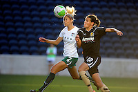 Red Stars defender Marian Dalmy (2) heads the ball while being pressured by FC Gold Pride midfielder Christine Sinclair (12).  The FC Gold Pride defeated the Chicago Red Stars 3-2 at Toyota Park in Bridgeview, IL on August 22, 2010