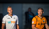 Mike van der Hoorn of Swansea City & Charlie Clough of Barnet during the 2017/18 Pre Season Friendly match between Barnet and Swansea City at The Hive, London, England on 12 July 2017. Photo by Andy Rowland.