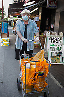 New York, New York City in the time of Coronavirus. Man shopping with his facemask, the new guidelines to public outings.