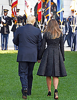 United States President Donald J. Trump and first lady Melania Trump hold hands as they walk back to the White House after leading a moment of silence in remembrance of those lost on September 11, 2001 on the South Lawn of the White House in Washington, DC on Monday, September 11, 2017.<br /> CAP/MPI/CNP/RS<br /> &copy;RS/CNP/MPI/Capital Pictures