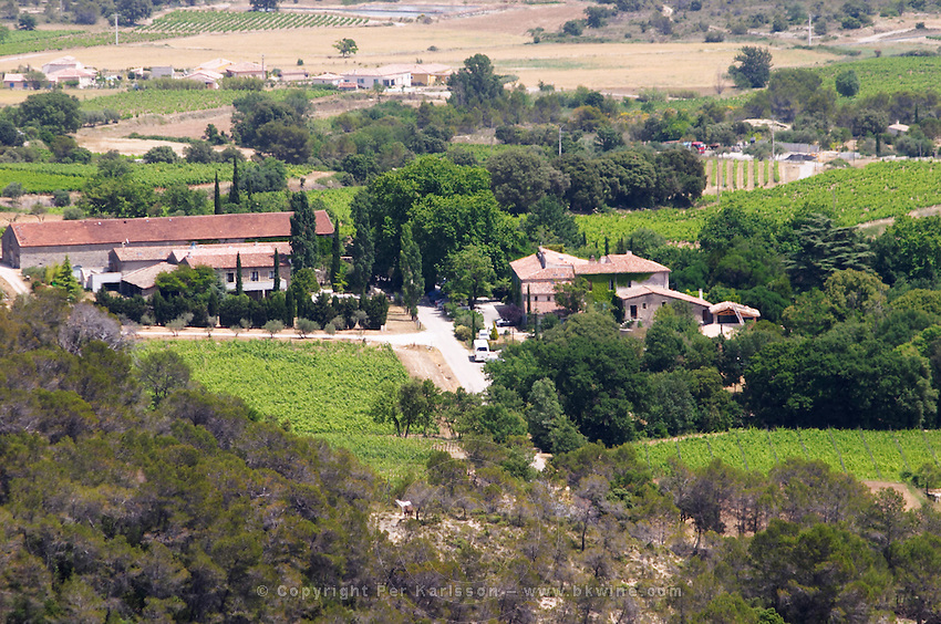 Domaine Cazeneuve in Lauret. Pic St Loup. Languedoc. Garrigue undergrowth vegetation with bushes and herbs. The winery building. France. Europe. Vineyard.