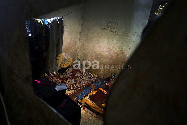 Palestinian children sleep inside their house during the power outage on winter season in the Jabalia refugee camp in the northern of Gaza Strip on January 11, 2017. Power shortages in the Palestinian enclave have occurred repeatedly in recent weeks, with homes in Gaza City typically getting around four hours a day - rather than at least eight normally. The roughly two million people in Gaza rely on one power plant, as well as imports from Israel and Egypt. Photo by Yasser Qudih