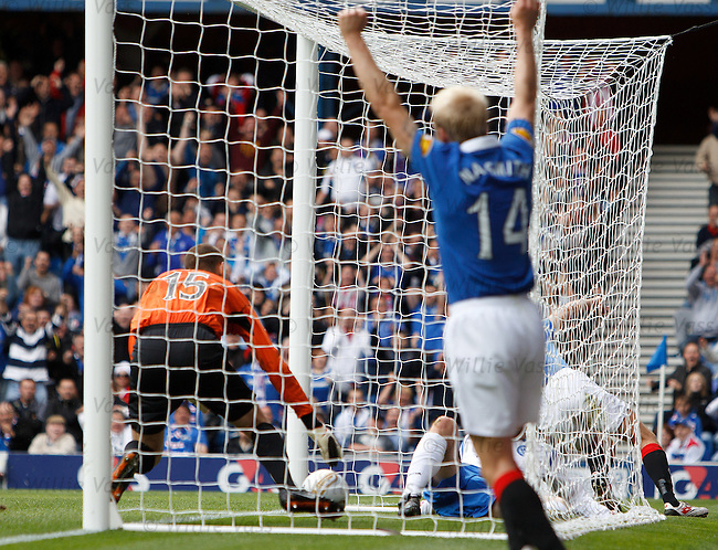Sasa Papac squeezes the rebound over the line to score for Rangers