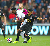 10th September 2017, Liberty Stadium, Swansea, Wales; EPL Premier League football, Swansea versus Newcastle United; Leroy Fer of Swansea City and Ayoze Perez of Newcastle United battle for possession during the match