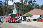 Red local bus passing Buddhist temple stupa,  Nuwara Eliya, Sri Lanka, Asia, Sri Lanka, Asia