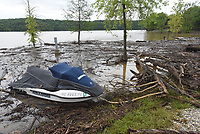 NWA Democrat-Gazette/FLIP PUTTHOFF <br />MUDDY MESS<br />A personal watercraft floats among wood debris Wednesday May 3 2017 near the swim beach at Horseshoe Bend park on Beaver Lake. Boaters should use caution, particularly on the south end of the lake, because of floating debris. The lake rose several feet after several rounds of rain.