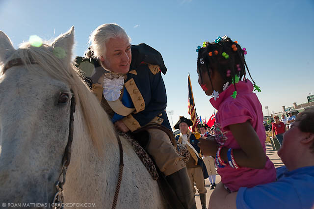 A little girl asks Mark Collins as General George Washington, if she can pet his horse at the North Houston Tea Party.