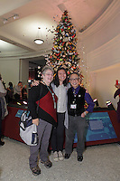 OrigamiUSA holiday tree at the Museum of Natural History, New York. Decorations and lightning ceremony. Rosalind Joyce, Jennifer Hou, Talo Kawasaki.