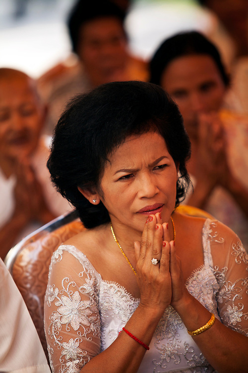 Mother of the bride at a buddhist wedding in a small village outside of Phnom Penh, Cambodia. <br /> <br /> Photos &copy; Dennis Drenner 2013.