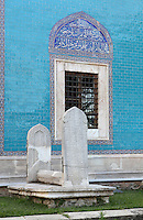Monument outside the Green Tomb or Yesil Turbe, mausoleum of the 5th Ottoman Sultan Mehmed I Celebi, Bursa, Turkey. On the tiled wall, a marble window frame is decorated with colourful Iznik tiles with Arabic inscriptions. The tomb was built by Mehmed's son and successor Murad II following Mehmed's death in 1421 and is so named because of the green-blue tiles which cover the exterior. The architect, Haci Ivaz Pasha, designed the tomb and the Yesil Mosque opposite. Most of the exterior tiles were replaced following an earthquake in 1855. Picture by Manuel Cohen