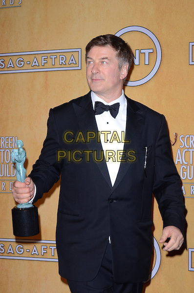Alec Baldwin.Pressroom at the 19th Annual Screen Actors Guild Awards held at The Shrine Auditorium, Los Angeles, California, USA..27th January 2013.SAG SAGs half length black tuxedo bow tie white shirt award trophy winner .CAP/ADM/TW.©Tonya Wise/AdMedia/Capital Pictures.