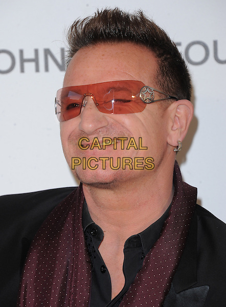 Bono of U2 (Paul David Hewson).The 21st Annual Elton John AIDS Foundation Academy Awards Viewing Party held at The City of West Hollywood Park in West Hollywood, California, USA..February 24th, 2013.oscars headshot portrait red black sunglasses shades funny smiling wink winking                                                .CAP/DVS.©DVS/Capital Pictures.