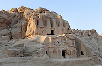 """Obelisk tomb, 1st century AD in Bab as-Siq and Triclinium, 25-75 AD, Petra, Ma'an, Jordan. These 2 Nabatean monuments are carved into the sandstone cliff. The upper Obelisk Tomb is crowned with four elongated pyramids representing """"nefesh"""", Nabatean signs commemorating the deceased. The lower gabled facade is the triclinium, a funerary dining hall with benches carved along 3 of its sides, where banquets were held in honour of a god or ancestor. Petra was the capital and royal city of the Nabateans, Arabic desert nomads. Picture by Manuel Cohen"""