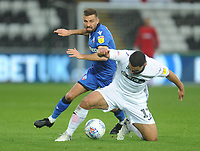 Bolton Wanderers' Gary O'Neil vies for possession with Swansea City's Cameron Carter-Vickers<br /> <br /> Photographer Kevin Barnes/CameraSport<br /> <br /> The EFL Sky Bet Championship - Swansea City v Bolton Wanderers - Saturday 2nd March 2019 - Liberty Stadium - Swansea<br /> <br /> World Copyright © 2019 CameraSport. All rights reserved. 43 Linden Ave. Countesthorpe. Leicester. England. LE8 5PG - Tel: +44 (0) 116 277 4147 - admin@camerasport.com - www.camerasport.com