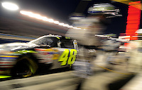 Feb 22, 2009; Fontana, CA, USA; NASCAR Sprint Cup Series driver Jimmie Johnson races off pit road during the Auto Club 500 at Auto Club Speedway. Mandatory Credit: Mark J. Rebilas-