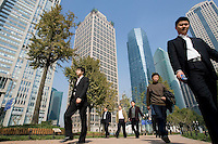 Employees walk in Luziajui business district during their lunch break, in Shanghai, China, on November 24, 2009. Photo by Lucas Schifres/Pictobank