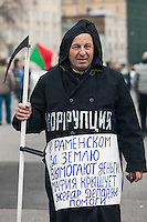 Moscow, Russia, 06/05/2013..A protester dressed as the Grim Reaper with the word ?Corruption? on his chest, as some 20,000 demonstrators protested against Russian President Vladimir Putin and demanded the release of political prisoners. The demonstration marked the first anniversary of a protest that descended into violence between protesters and police and resulted in over 600 arrests.