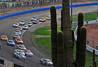 Nov. 9, 2008; Avondale, AZ, USA; NASCAR Sprint Cup Series drivers race through turn three during the Checker Auto Parts 500 at Phoenix International Raceway. Mandatory Credit: Mark J. Rebilas-
