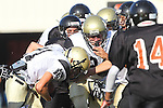 Beverly Hills, CA 09/23/11 - Andrew Phillips (Peninsula #11) and James Houk (Peninsula #70) in action during the Peninsula-Beverly Hills frosh football game at Beverly Hills High School.
