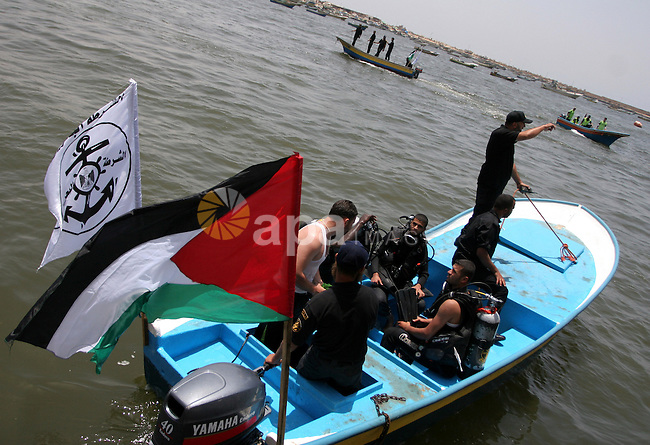 "Hamas marine security take to the open waters during a drill in preparation for the arrival of ships expected to break the Israeli naval blockade on the port in Gaza City on the coast of the Mediterranean Sea on May 26, 2010. Israel claimed a flotilla of pro-Palestinian activists seeking to bust the Gaza blockade is a provocation and that the aid it is carrying is ""unnecessary."" Three cargo vessels left from Ireland, Greece and Turkey in recent days and plan to rendezvous with six smaller passenger boats off the coast of Cyprus before steaming on to Gaza where organisers hope to arrive by May 29. Photo by Ashraf Amra"