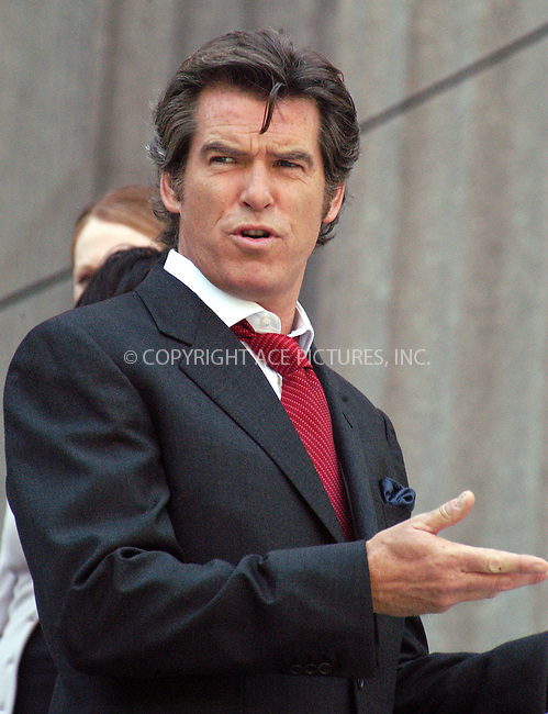 "Pierce Brosnan and Julianne Moore filming their new movie, ""The Laws of Attraction"" on the steps of Manhattan's Courthouse. Pierce Brosnan plays a divorce lawyer who falls in love with and weds another divorce attorney (Julianne Moore). If any couple can avoid the pitfalls and problems plaguing so many marriages, it's this one, right? Wrong.....New York, August 14, 2003. Please byline: NY Photo Press.   ..*PAY-PER-USE*      ....NY Photo Press:  ..phone (646) 267-6913;   ..e-mail: info@nyphotopress.com"