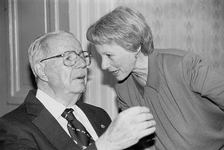 "Former Minority Leader Sen. Hugh Doggett Scott, R-Pa., and Sen. Nancy Landon Kassebaum Baker, R-Kans., talking with each other at his ""90th Birthday Party"". October 4, 1990 (Photo by Maureen Keating/CQ Roll Call)"