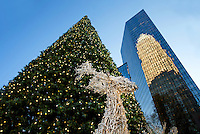 Charlotte Christmas Photography - <br /> <br /> Photography of the decorate Christmas tree located in the center of uptown/downtown Charlotte at Trade and Tryon Street.  Bank of America Corporate Center is reflected in the background against the large decorated holiday Christmas Tree.<br /> <br /> Charlotte Photographer - PatrickSchneiderPhoto.com