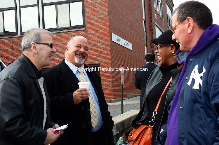 WATERBURY, CT-05 November 2014-110414TK09- Hasan Cela, Anthony Piccochi, Majority Leader for Waterbury Board of Alderman and Kim and James Rivnack share a moment before entering Tinker School to cast their voting selections. Cela was passing out voting information in behalf of Karl D. Shehu running for  State Senator.. Tom Kabelka Republican-American
