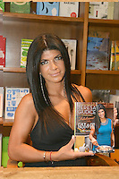 """CORAL GABLES, FL - JUNE 09: Teresa Giudice, of tv's The Real Housewives of New Jersey, promotes and signs copies of her book """"Fabulicious!: Fast & Fit"""" at Books and Books on June 9, 2012 in Coral Gables, Florida. © mpi1/MediaPunch Inc. NORTEPHOTO.COM"""