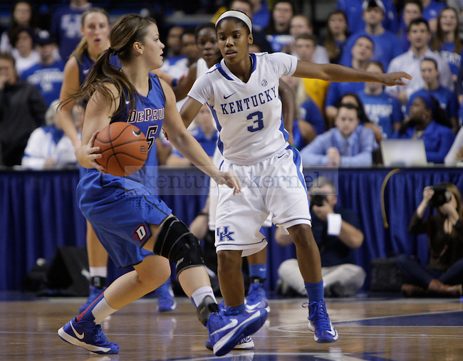 Freshman point guard, Janee Thompson, tries to steal the ball from DePaul's Anna Martin. The University of Kentucky Women's Basketball team hosted DePaul University Friday, Dec 07, 2012 at Rupp Arena in Lexington. Photo by Kirsten Holliday | Staff