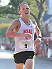Brendan Martin, 26, of Smithtown becomes the first Long Islander to cross the finish line of Northport's annual Cow Harbor 10-kilometer run on Saturday, September 19, 2015. He took fifth place overall with a time of  30:39.87.<br /> <br /> James Escher