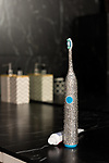 Pictured: A crystallised electric toothbrush created by Vinceri to celebrate the launch of Logic Compact Crystal. <br /> <br /> A renowned artist has transformed household objects into works of crystal encrusted art, including an electric toothbrush, vegetable peeler and phone charger.  Vince Vinceri, a crystal artist, has made a career from adding glitz to the already glam such as covering a Lamborghini with more than one million crystals.<br /> <br /> For his latest project, Mr Vinceri has taken on the challenge of turning everyday objects into gleaming masterpieces.  Given an electric toothbrush, calculator, vegetable peeler, bottle opener and phone charger, Mr Vinceri and his team spent more than 50 hours making them sparkle using nearly 5,000 crystals.  SEE OUR COPY FOR DETAILS.<br /> <br /> © Solent News & Photo Agency<br /> UK +44 (0) 2380 458800