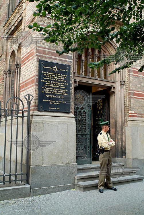 An armed policeman guards the recently restored New Synagogue in the Mitte district.