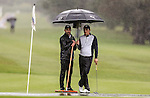 Ryan Chisnall holds the brollie for master squeegy operator George Harper Jnr during the Barfoot and Thompson Charles Tour, Akarana Open, Akarana Golf Club, Auckland, Sunday 17  April 2016. Photo: Simon Watts/www.bwmedia.co.nz