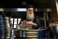 Mount Athos - The Holy Mountain.<br /> A monk prepares dinner.<br /> <br /> Photographer: Rick Findler