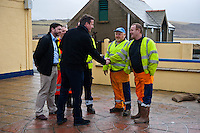 Wednesday 19 February 2014<br /> Pictured:( L-R )  Prime Minister David Cameron talks workers from Pembrokeshire County Council who helped clear up after the flooding<br /> Re: Prime Minister David Cameron Visits Flood victims at the Duke of Edinburgh public house in Newgale, Pembrokeshire, Wales