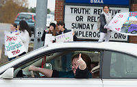 NWA Democrat-Gazette/CHARLIE KAIJO A driver shows support for Dreamers on Friday, November 10, 2017 during a rally and three mile march that started at Rogers High School in Rogers. Marchers met to express support for the Dream Act and TPS (Temporary Protective Status). The march in Rogers is the third of a four-city tour for supporters of Dreamers. The final march will be in Bentonville in December, mostly likely before Congress goes into recess, said Andrea Garcia, a spokesman for the group.