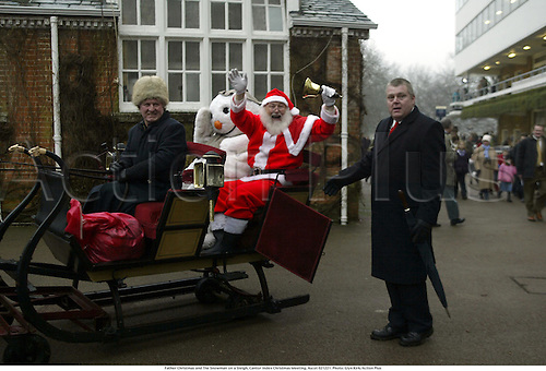 Father Christmas and The Snowman on a Sleigh, Cantor Index Christmas Meeting, Ascot 021221. Photo: Glyn Kirk/Action Plus...2002.horse racing.santa national hunt